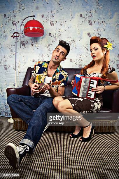 Rockabilly Couple Playing Ukelele and Accordion on Couch