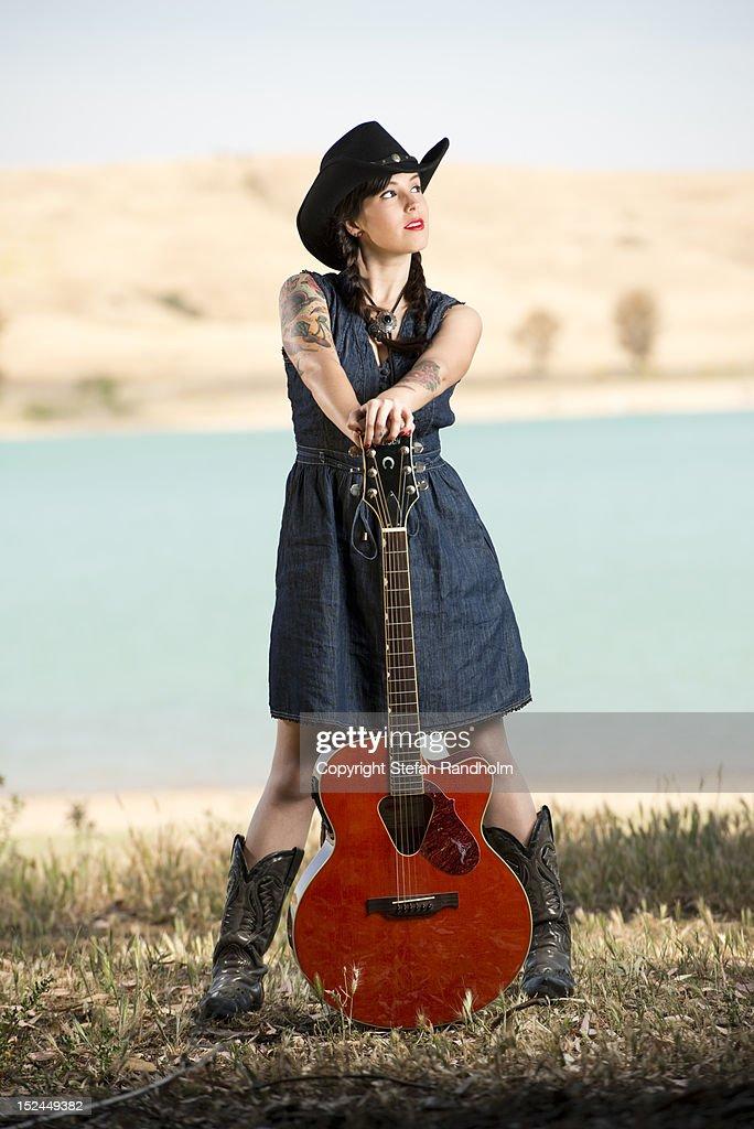 Rockabilly girl holding guitar   Stock Photo 5a7af94dfb9b