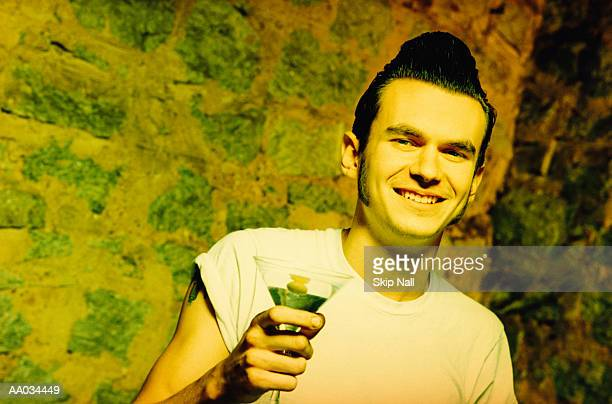 rockabilly in club with martini glass - sideburn stock pictures, royalty-free photos & images