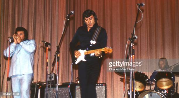 Rockabilly pioneer Carl Perkins performs at The Dome on April 28, 1977 in Brighton, England.