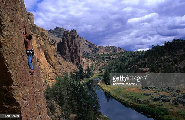 rock-climbing in the popular smith rock state park. - smith rock state park stock pictures, royalty-free photos & images