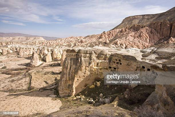 Rock-cut dwellings on an exposed cliff in the city of Cavusin, Avanos, Nevsehir Province, Central Anatolia , Turkey. The whole valley is honeycombed...