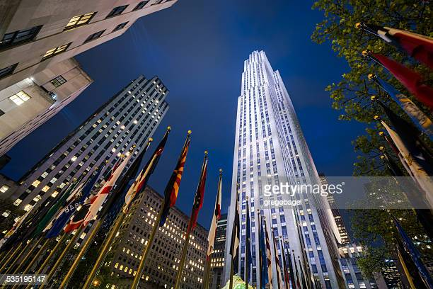 rockefeller center in manhattan of new york city at night - rockefeller center stock pictures, royalty-free photos & images