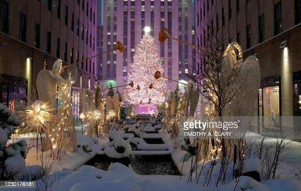 Rockefeller Center is seen in the snow on December 17, 2020 in New York, the morning after a powerful winter storm hit the US northeastern states. -...