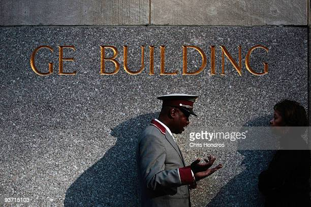 Rockefeller Center security guard talks to a woman at the base of the headquarters of General Electric owner of NBC Universal December 3 2009 in New...