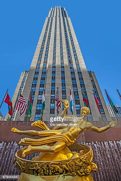 rockefeller center with gold statue of promethus - eric van den brulle stock pictures, royalty-free photos & images