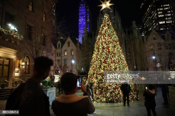 Rockefeller Christmas tree stands lit during the 85th Rockefeller Center Christmas Tree Lighting ceremony at Rockefeller Center in New York United...