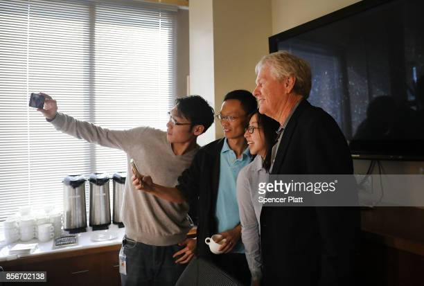 Rockefeller University biologist Michael Young poses for pictures with students after winning the Nobel Prize in Physiology or Medicine on October 2...