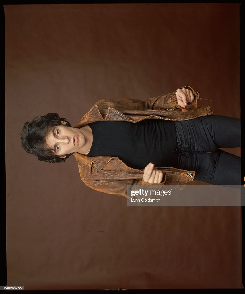 Rocker Bruce Springsteen in jeans and brown leather jacket. Undated photograph.