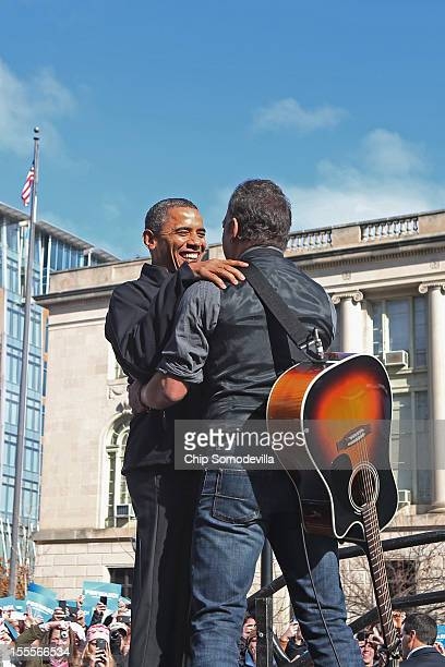Rocker Bruce Springsteen welcomes US President Barack Obama to the stage during a rally on the last day of campaigning in the general election...