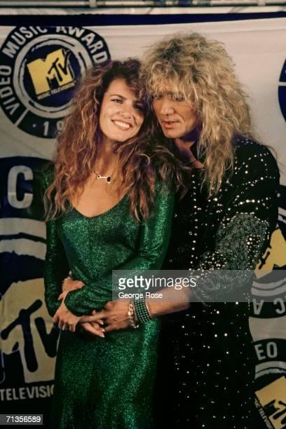 Rocker David Coverdale of the rock group Whitesnake poses with his girlfriend Tawny Kitaen at the 1987 MTV Music Awards at Universal City California...