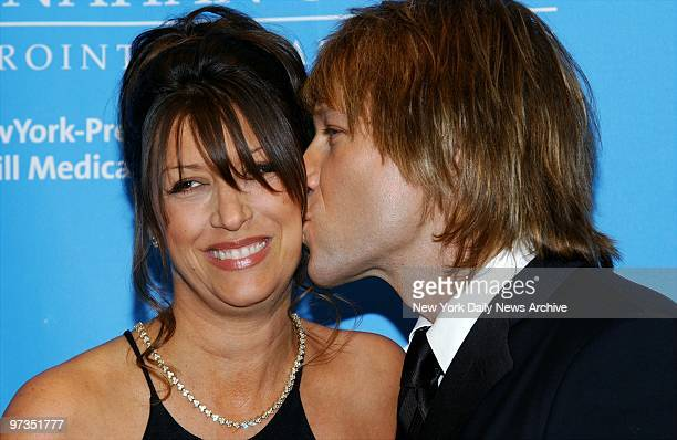 Rocker Jon Bon Jovi plants a kiss on wife Dorothea during a bash aboard the Queen Mary 2 at Pier 92 benefiting the Entertainment Industry...