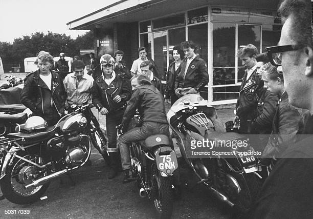 Rockers British youths into leather scruffy clothes motorcyles rock music visiting a roadside cafe