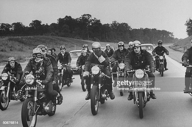 Rockers British youths into scruffy clothes motorcyles and leather tearing along road in convoy