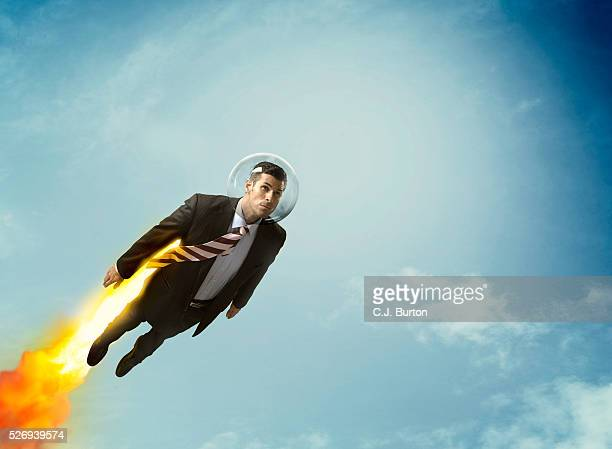 rocket businessman flying in sky - superhero stock pictures, royalty-free photos & images
