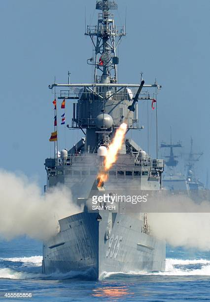 A rocket fires from a USmade Perryclass frigate during the Han Kuang drill at sea neat eastern Hualien on September 17 2014 Taiwanese navy fired...