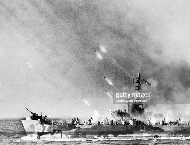 A rocket firing Landing Craft Infantry helps soften up Okinawa for our troops landing there Okinawa Japan April 1 1945