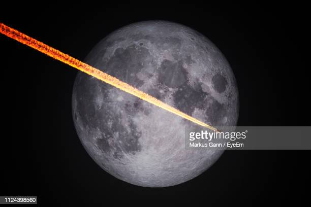 rocket flying by moon against sky - space exploration stock pictures, royalty-free photos & images