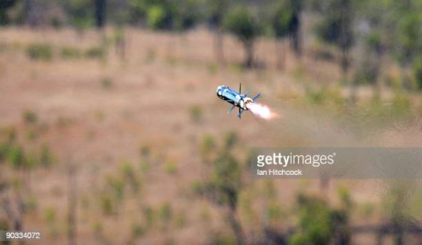 A rocket from a shoulder fired Javelin portable antitank weapon is launched during an Army fire power demonstration at Range Control High Range on...