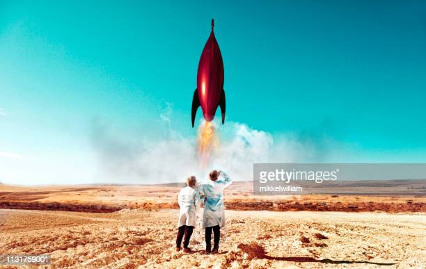 Rocket launch in desert carried out by two children wearing labcoats
