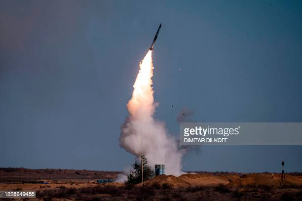 """Rocket launches from a S-400 missile system at the Ashuluk military base in Southern Russia on September 22, 2020 during the """"Caucasus-2020"""" military..."""