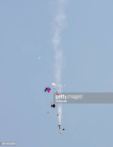 rocket parts drift to earth via parachutes - spaceport america stock pictures, royalty-free photos & images