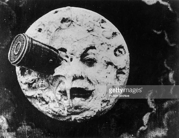 A rocket ship crashes into the moon in a still from director Georges Melies's film 'A Trip to the Moon' 1902