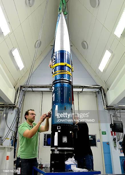 "Rocket technicians of the SSC assemble the student rocket ""Rexus 11"" at the Esrange Space Centre near Kiruna on November 15, 2012. AFP PHOTO/JONATHAN..."