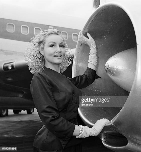 Rocketing to Filmdom. Julie Newmar, who has scored in several Broadway Hits, pauses beside jet engine intake before streaking to Hollywood via TWA....