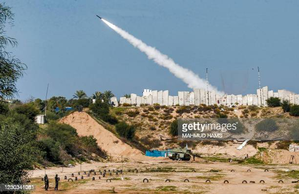 Rockets are fired during a military drill by Palestinian Islamist movement Hamas and other Palestinian armed factions in Gaza City on December 29,...