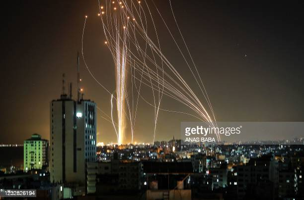 Rockets are launched from Gaza city, controlled by the Palestinian Hamas movement, in response to an Israeli air strike on a 12-storey building in...