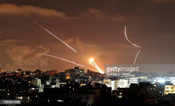 Rockets are launched from Gaza City, controlled by the Palestinian Hamas movement, towards Israel on May 12 amid the most intense Israeli-Palestinian...