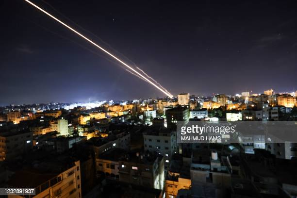 Rockets are launched from Gaza City, controlled by the Palestinian Hamas movement, towards Israel early on May 15, 2021. - Israel faced a widening...