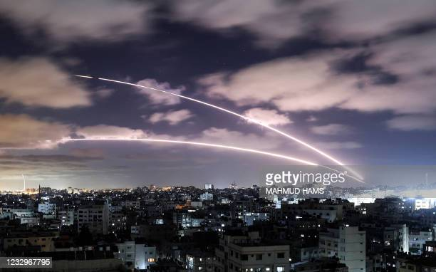 Rockets are launched towards Israel from Gaza City, controlled by the Palestinian Hamas movement, on May 18 amid a flare-up of Israeli-Palestinian...
