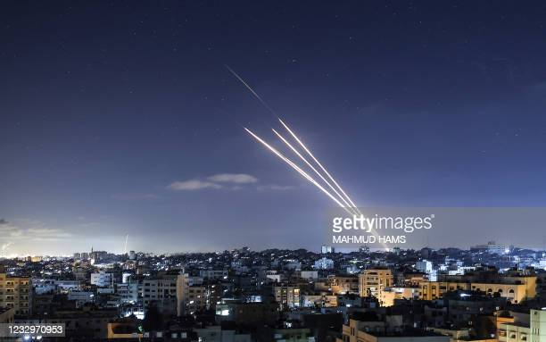 Rockets are launched towards Israel from Gaza City, controlled by the Palestinian Hamas movement, on May 18, 2021. - Heavy air strikes and rocket...