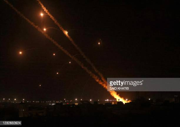 Rockets are launched towards Israel from Rafah, in the southern Gaza Strip, early on May 12, 2021. - Palestinian militants Hamas said on May 12 that...