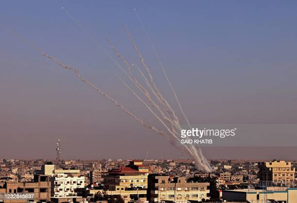 Rockets are launched towards Israel from Rafah, in the southern the Gaza Strip, controlled by the Palestinian Hamas movement, on May 12, 2021. -...