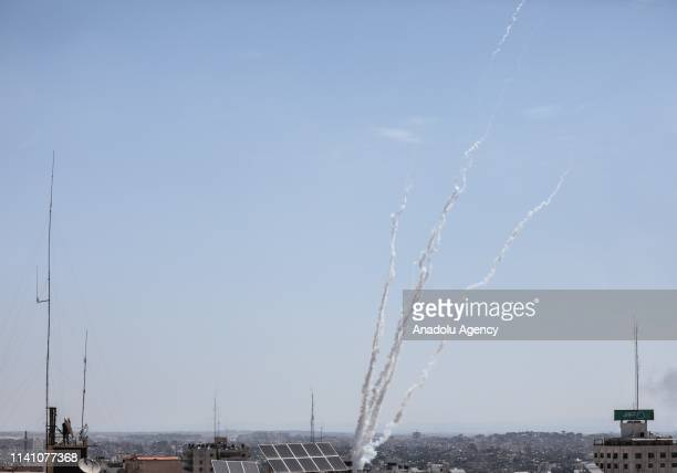 Rockets are thrown to Israeli side from Gaza after Israeli attacks killing four Palestinians, including a teenager in the blockaded Gaza Strip, in...