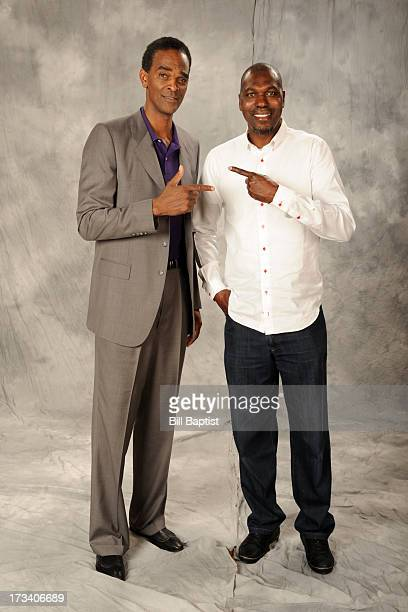 Rockets center legends Hakeem Olajuwon and Ralph Sampson pose for a photograph after Dwight Howards press conference on July 13 2013 at The Toyota...