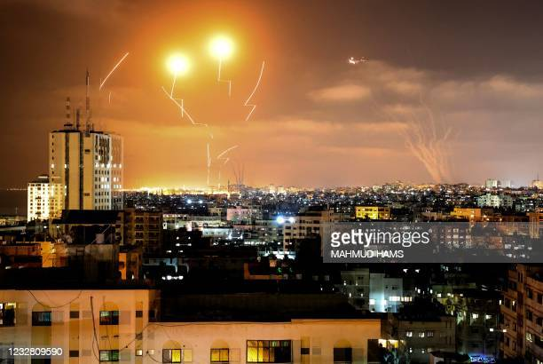 Rockets fired towards Israel from Gaza City, controlled by the Palestinian Islamist movement Hamas, are intercepted by Israel's Iron Dome Aerial...