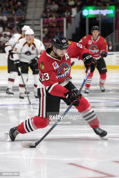 Rockford IceHogs C Vinnie Hinostroza shoots the puck during the third period of the AHL hockey game between the Rockford IceHogs and Cleveland...