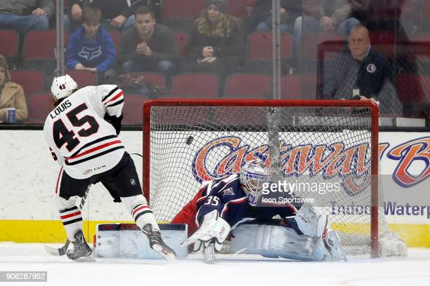 Rockford IceHogs center Anthony Louis puts the puck past Cleveland Monsters goalie Matiss Kivlenieks during the shootout of the American Hockey...