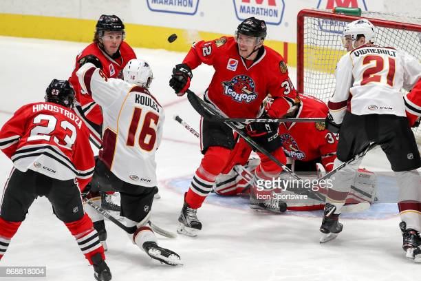 Rockford IceHogs center Luke Johnson Cleveland Monsters center Miles Koules Rockford IceHogs defenceman Carl Dahlstrom and Cleveland Monsters center...