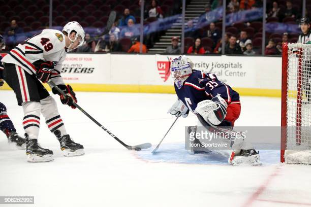 Rockford IceHogs left wing Graham Knott shoots and scores against Cleveland Monsters goalie Matiss Kivlenieks during the first period of the American...