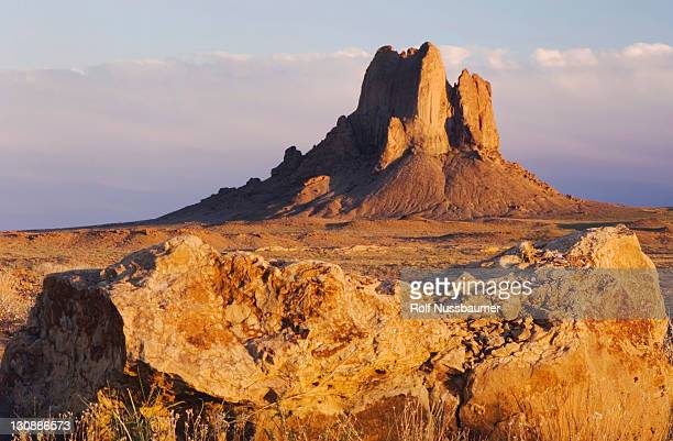 rockformation at sunset, shiprock, navajo indian reserve, new mexico, usa - shiprock stock photos and pictures