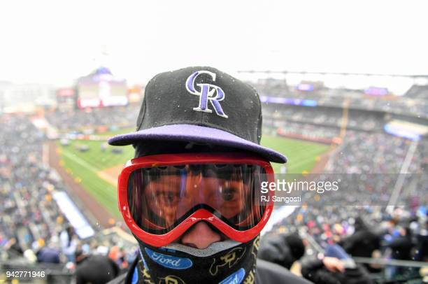 Rockies fan Brendan Allen is dressed for the weather during the home opener at Coors Field on April 6 2018 in Denver Colorado The game between the...