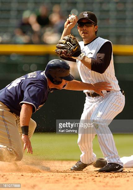 ROXPADRES DENVER CO Rockies secondbaseman Kaz Matsui makes the force out on Padres baserunner Brian Giles in the ninth inning after shortstop Jamey...