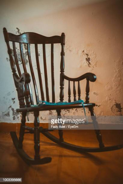 rocking chair at table - rocking chair stock photos and pictures