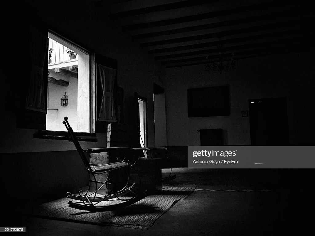 Rocking Chair In Empty Room  Stock Photo & Rocking Chair In Empty Room Stock Photo | Getty Images