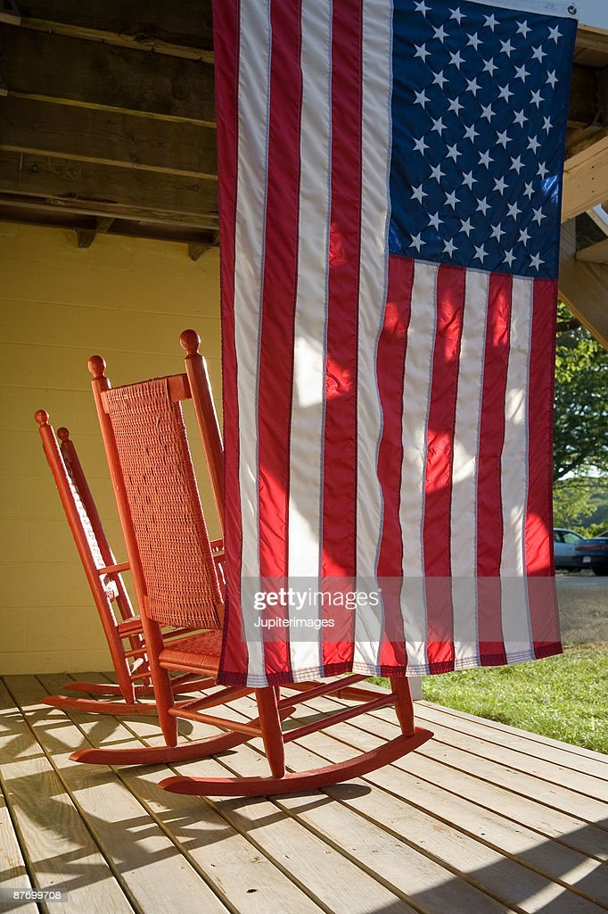 Rocking Chairs And American Flag On Porch : Stock Photo